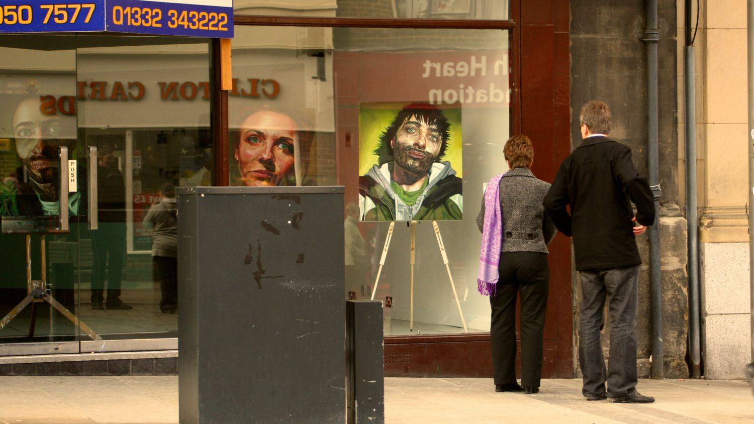 two paintings being view by two people in derby in 2010