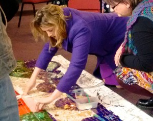 minister adds tile to mosaic